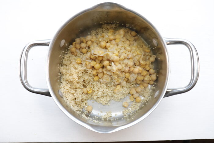 Chickpeas and quinoa in pot to mash