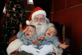 twins screaming on santas lap