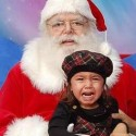 kid screaming on santas lap