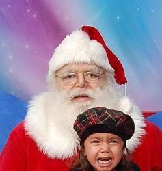 kid screaming on santas lap