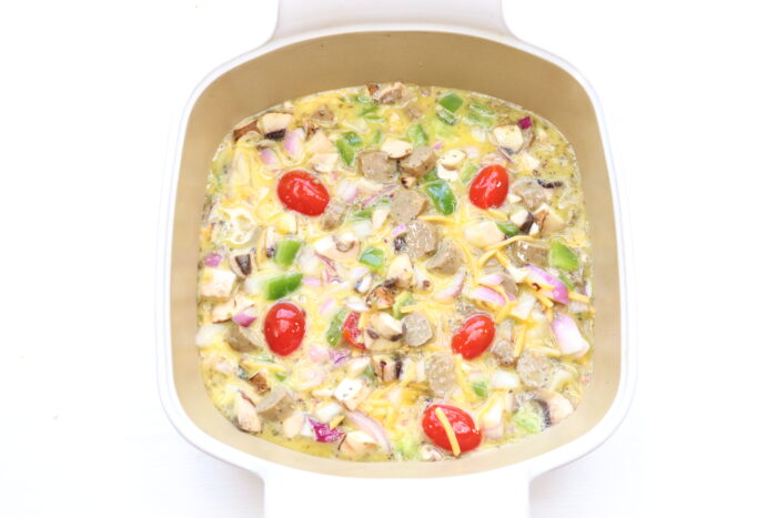 Breakfast casserole in a baking dish ready to cook