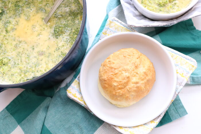 Weight Watchers Bread Bowl on white plate next to broccoli soup