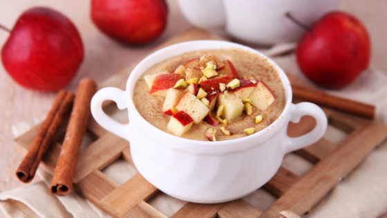 Cinnamon Apple Oatmeal next to apples