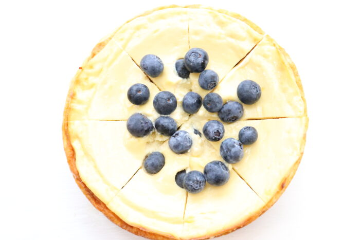 top view of weight watchers cheesecake topped with blueberries ready to eat