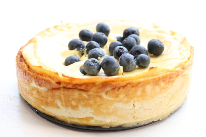 side view of zero point cheesecake with blueberries on top