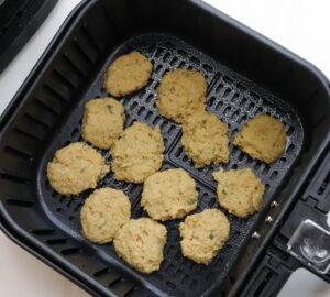 air fryer falafel patties uncooked in air fryer basket