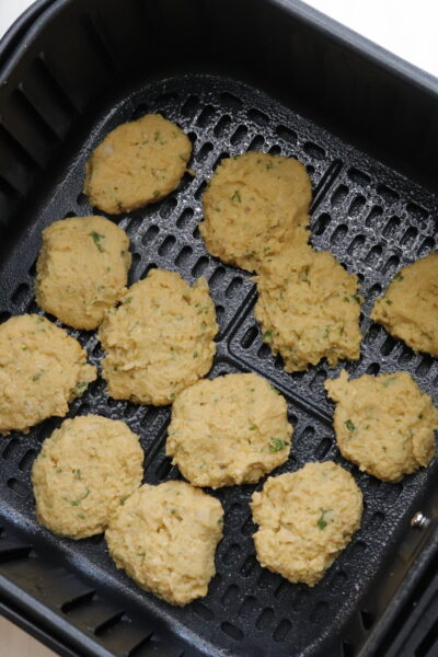 air fryer falafel patties uncooked in air fryer basket