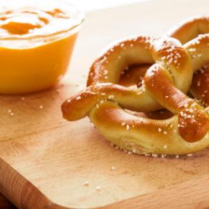 beer cheese dip next to pretzels