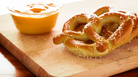 beer cheese dip next to pretzels