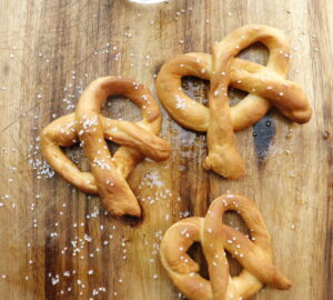 3 air fried pretzels on cutting board