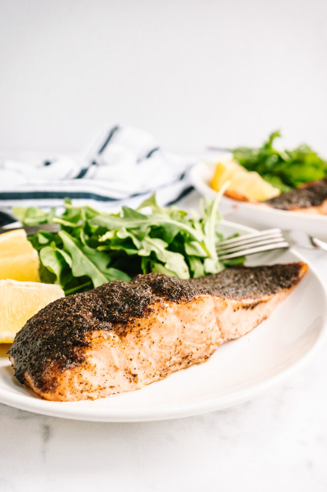 side view of air fried salmon with salad