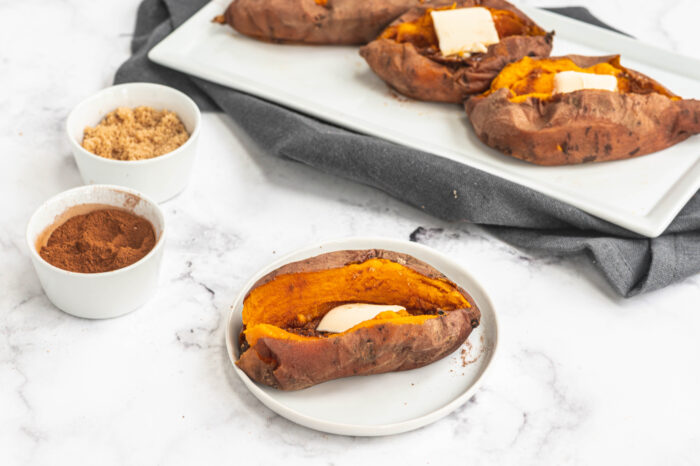 instant pot sweet potato whole cut open with butter