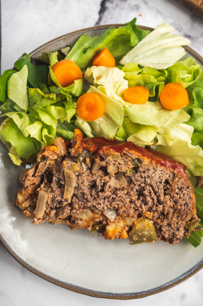 top view of instant pot meatloaf next to salad