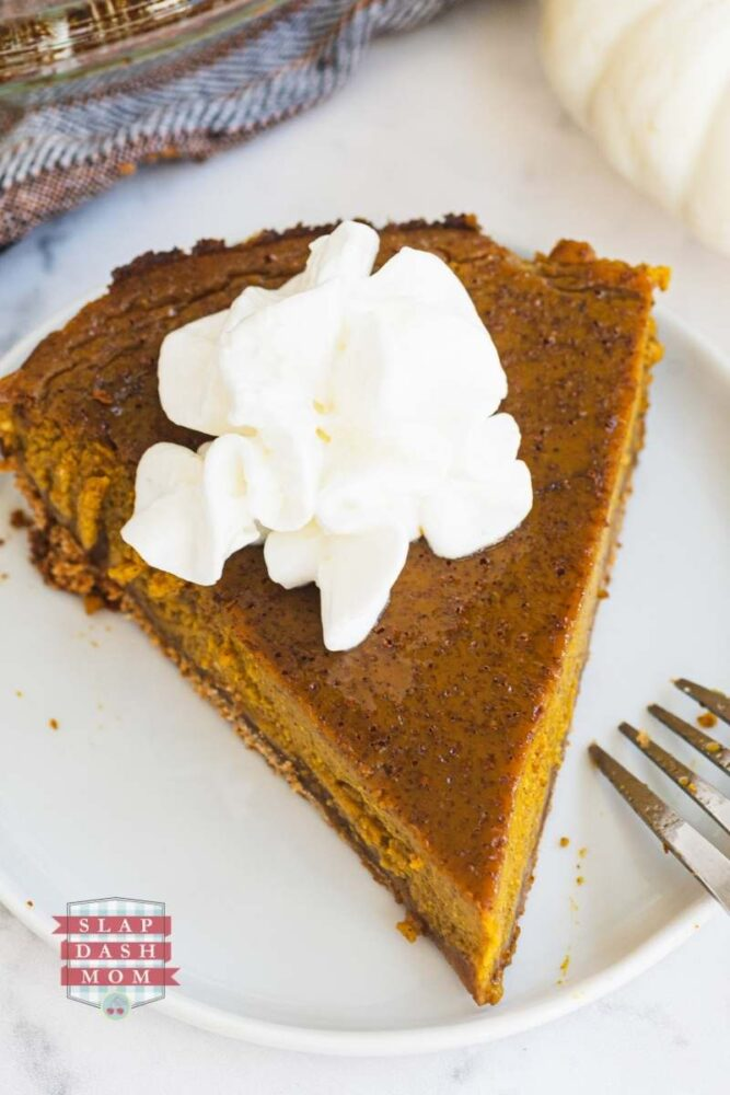 close up of pumpkin pie with coconut milk with whipped topping