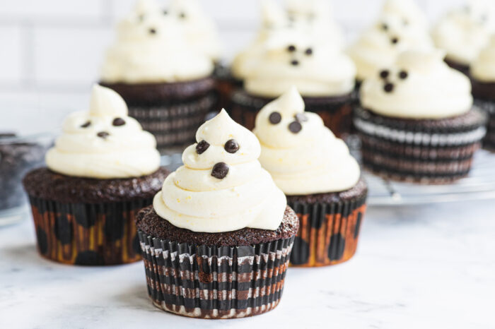 front view of ghost cupcakes with chocolate chips for eyes